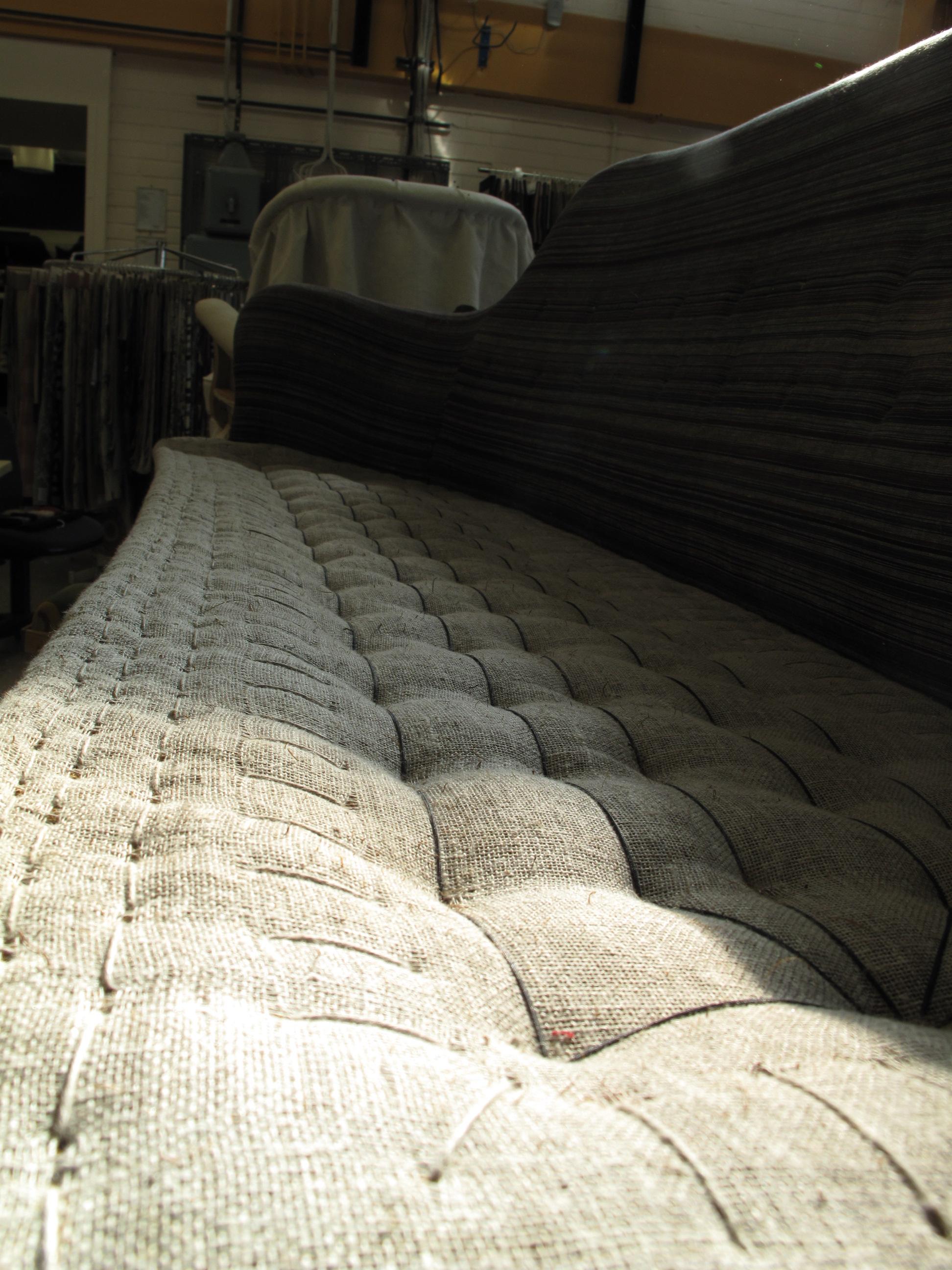 Soffa omstoppad av Tapetserare